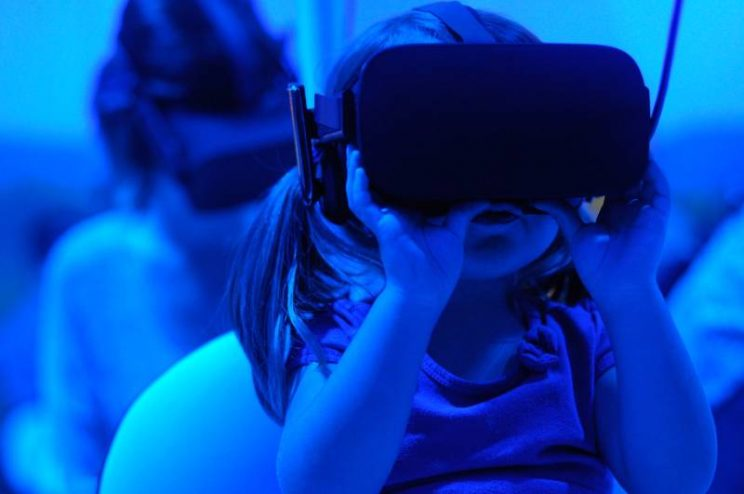 kid wearing VR goggles